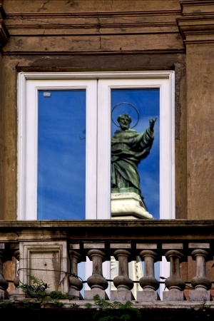 a statue of a saint in a window in naples