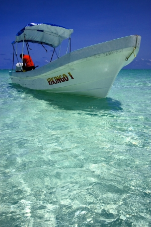 poppa: a boat in the blue lagoon of sian kaan in mexico