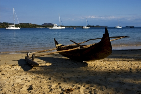 madagascar nosy be rock stone branch yacht boat palm lagoon and coastline Stock Photo