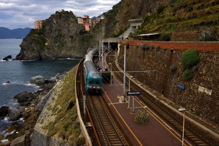 the stairs and the railway in village of manarola in the north of italy,liguria photo