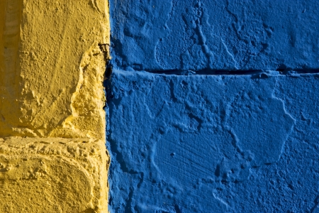 colored wall yellow and blue in la boca buenos aires argentina photo