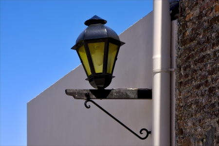 a street lamp and a water pipe in colonia del sacramento  uruguay Stock Photo - 17348529