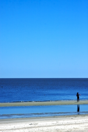 sunburnt: women became sunburnt and walk  in beach rio de la plata colonia del sacramento uruguay  Stock Photo
