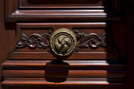 a brass brown knocker and wood  door colonia del sacramento uruguay Stock Photo - 17348518