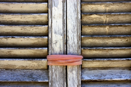 brown wood venetian blind and a pink rope in colonia del sacramento uruguay photo