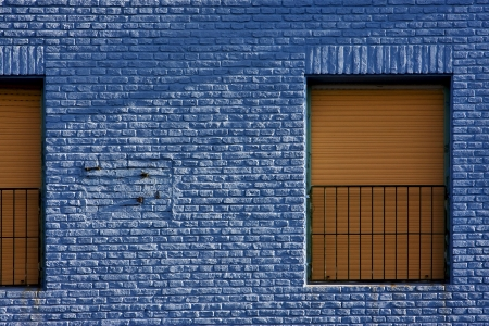 old yellow window in light blue wall in the centre of la boca buenos aires argentina photo
