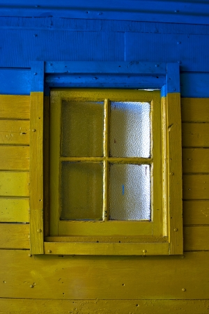 old yellow window in blue wall in the centre of la boca buenos aires argentina  Stock Photo - 17478185