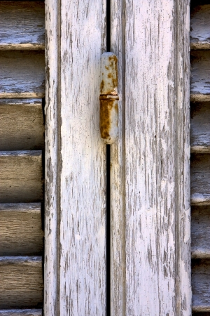 brown wood venetian blind and the rusty in colonia del sacramento uruguay Stock Photo - 17478210