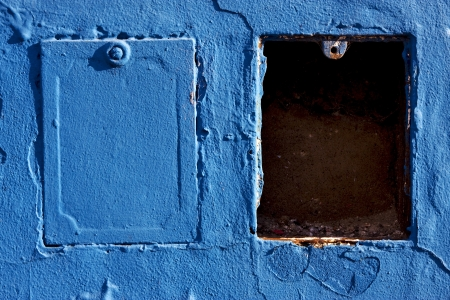two metal box and a blue wall in la boca buenos aires argentina Stock Photo - 17478252