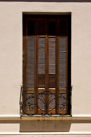 old window grate and terrace in the centre of colonia del sacramento uruguay