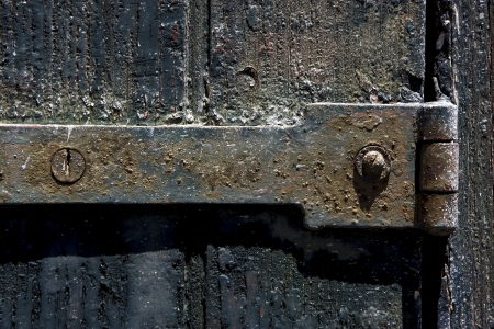 a old iron metal lock screw and wood in the centre of colonia del sacramento uruguay Stock Photo - 17478241