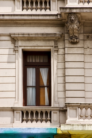 old window little terrace colors and head of lion  in the centre of buenos aires argentina Stock Photo - 17711525