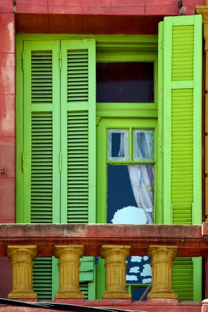 light green wood venetian blind and a red terrace  wall in la boca buenos aires argentina Stock Photo - 17711496
