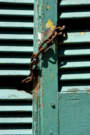 light green wood venetian blind and a rusty chain in la boca buenos aires argentina Stock Photo - 17711489