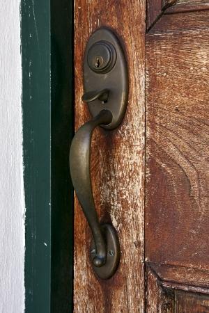 a brass brown knocker and wood  door colonia del sacramento uruguay Stock Photo - 17711826