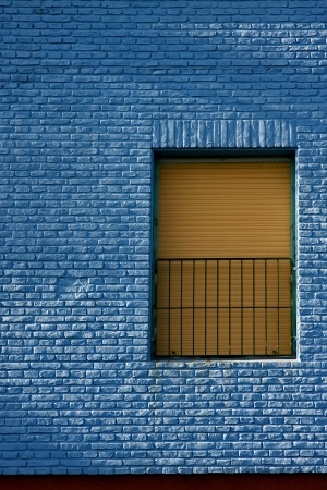 old yellow window in light blue wall in the centre of la boca buenos aires argentina Stock Photo - 17830799