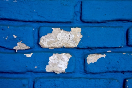 colored and broken blue wall   in colonia del sacramento uruguay photo