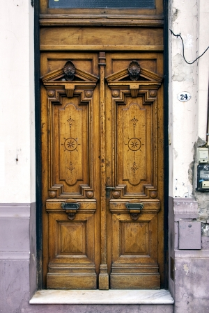 a brown wood old door in the centre of buenos aires argentina Stock Photo - 17830776