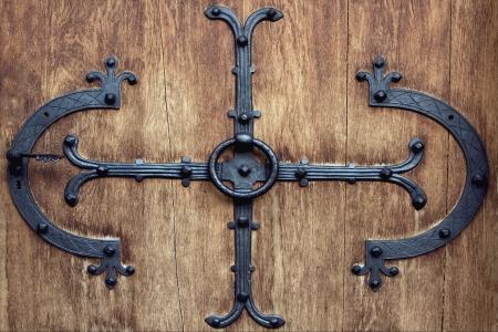 a brass brown knocker and wood  door neuschwainstain germany Stock Photo - 17830850
