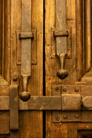 brown iron safety lock in a closed wood  door in naples italy Stock Photo - 17830874