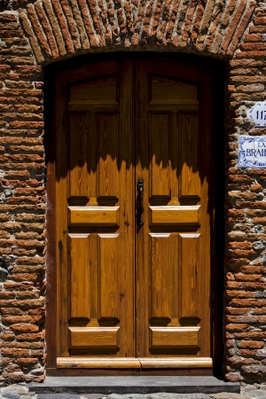 brown wood old door  in the centre of colonia del sacramento uruguay photo
