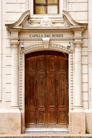 brown wood old door of a church capilla san roque in the centre of buenos aires argentina  photo