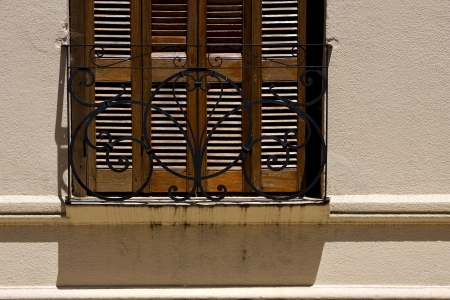 old window grate and shadow in the centre of colonia del sacramento uruguay Stock Photo - 17820959