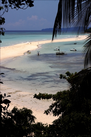 isthmus: isthmus isle boat palm  rock stone branch hill lagoon and coastline in madagascar nosy be