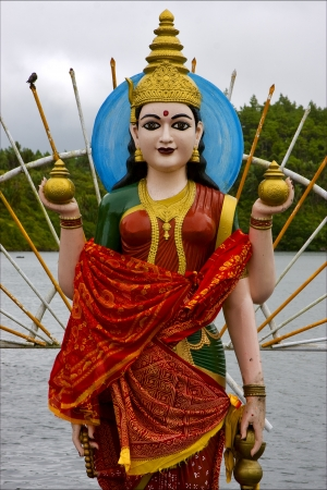 marble  wood statue of a Hinduism  women  Shiva vishnu Brahma in a temple near a lake in mauritius africa  photo