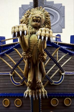 curve claw: lion port louis wood statue of a Hinduism  women  Shiva vishnu Brahma in a temple near a lake in mauritius africa  Stock Photo