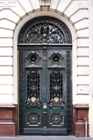 brown wood old green door and  head of lion in a house the centre buenos aires argentina  photo