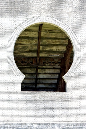 old window and wall in plaza de toros centre of colonia del sacramento uruguay photo