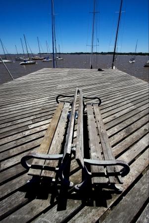 colonia del sacramento: harbor water coastline bench and summer in   rio de la plata colonia del sacramento uruguay