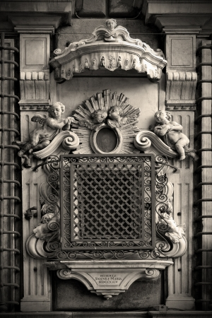 genova facade  and window with grate in the old church  italy Standard-Bild