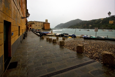 boat water house and coastline in sestri levante italy photo