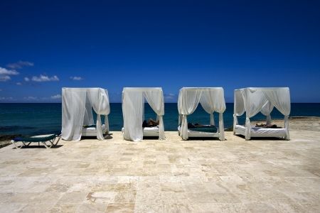 republica dominicana bed curtain tent pillow peace marble and relax near the caribbean beach photo