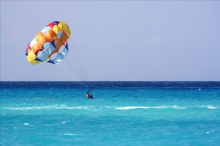 playa del carmen mexico parachute water skiing in the ocean Stock Photo