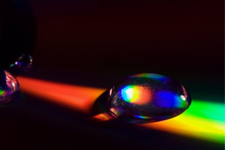 rainbow drop in a plastic cd material abstract
