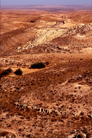 matmata: brown desert street and hill in matmata tunisia Stock Photo