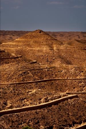 matmata: brown desert street and hill in matmata tunisia Stock Photo