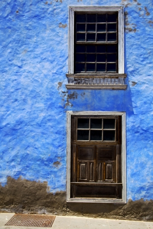 blue wood   couple of window in a paint wall arrecife lanzarote spain Stock Photo - 21148165