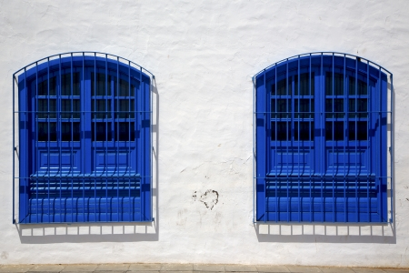 blue wood   couple of window in a white wall arrecife lanzarote spain photo