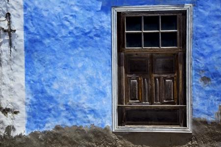 brown wood   window in a blue wall arrecife lanzarote spain Stock Photo - 21148167