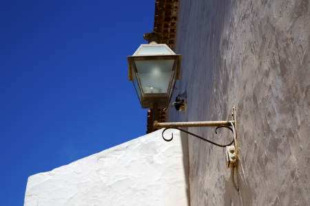 spain street lamp a bulb in the blue sky wall arrecife teguise lanzarote Stock Photo - 21805748