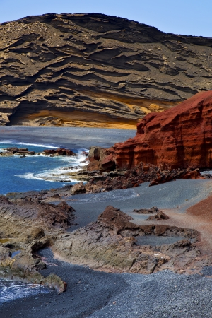 in el golfo lanzarote spain musk pond rock stone sky  water  coastline and summer   photo