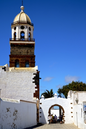 arrecife lanzarote  spain the old wall terrace church bell tower plant in teguise  photo