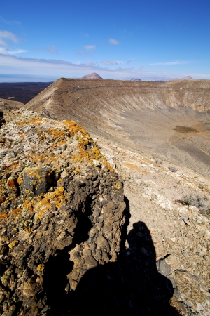 timanfaya  in los volcanes volcanic rock stone sky  hill and summer  lanzarote spain plant flower bush  photo