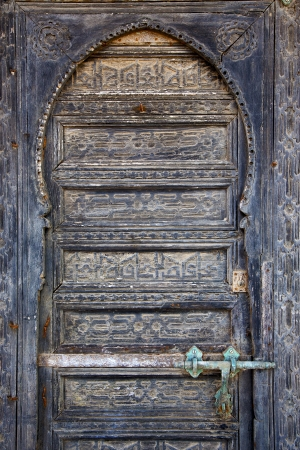 piece of colorated   wood as a  door in lanzarote spain Stock Photo - 21955510
