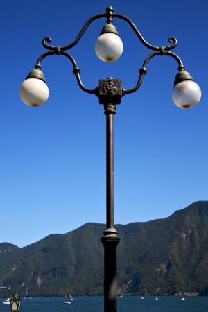street lamp a bulb in the   sky lake of lugano Switzerland Swiss  photo