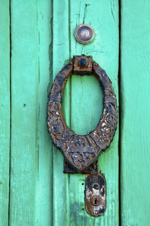 spain knocker lanzarote abstract door wood in the green  photo